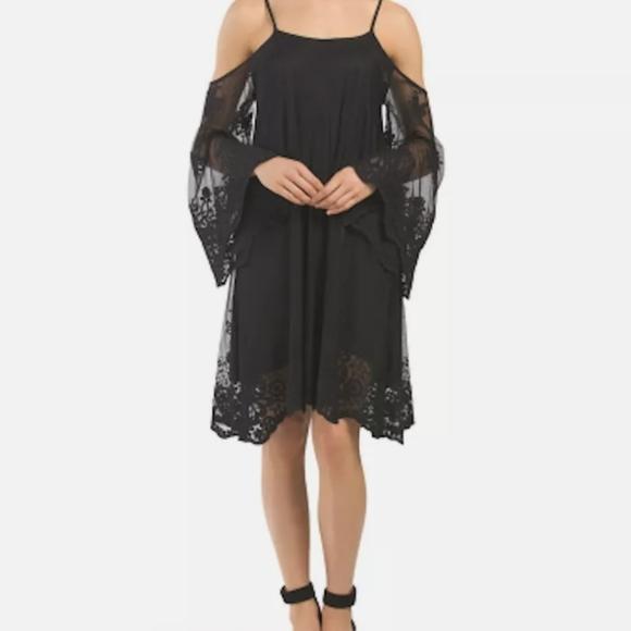 Off the shoulder black lace Elan dress